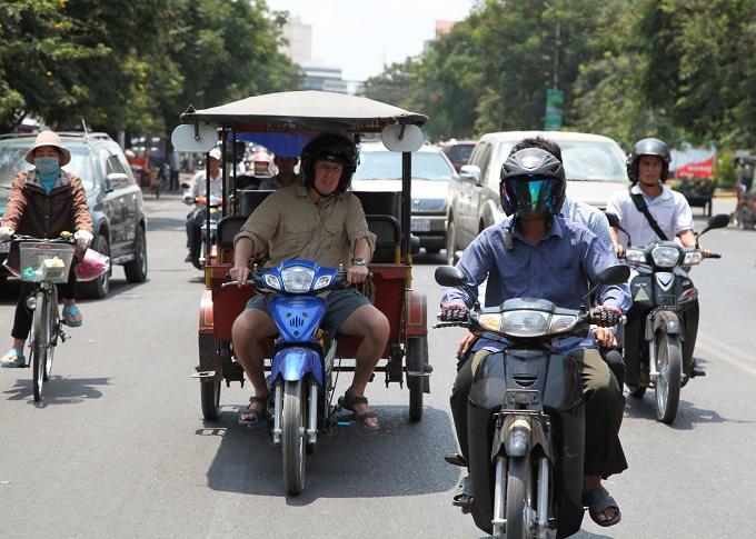 Mason McQueen driving a tuk tuk in episode 1 of A Cabbie Abroad - Image Credit: BBC