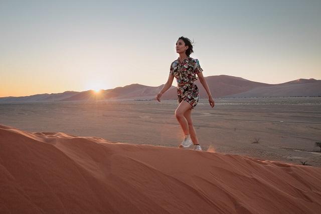 Anita Rani climbing the ancient dunes of the Namib desert - Image Credit: BBC. Photographer: Jacob Robinson